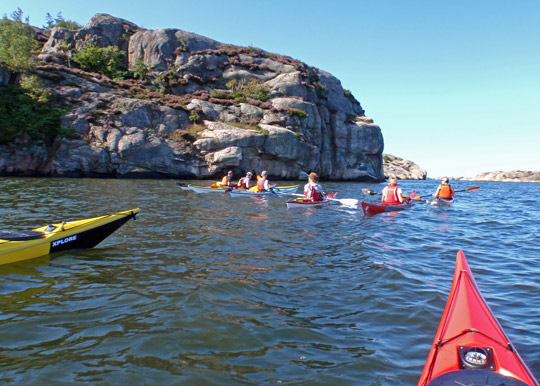A number of KF Öresund kayaks passing nort west point of Valön ready to make first open water crossing