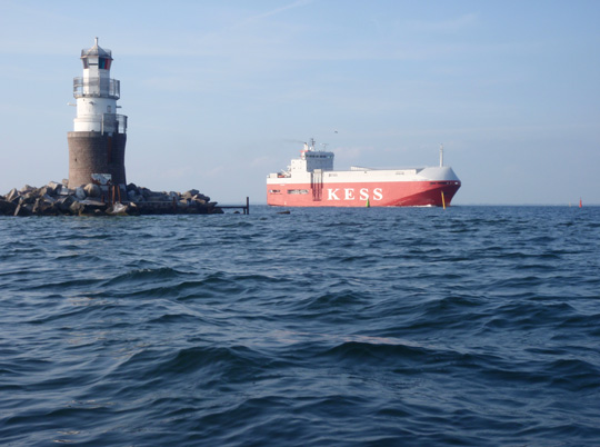 the big ship kess just passes the lighthouse rat trap