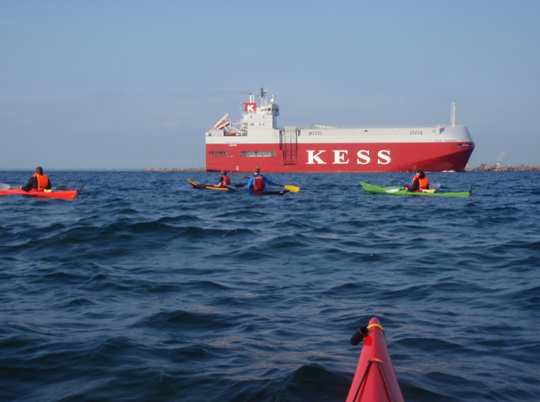 the big ship KESS now on its way into the Malmö Harbour while KF Öresund kayak club looks at it