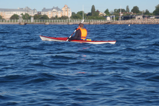 here is the kayaker paddling on his way home before some time later falling into the water