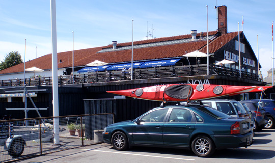 Our Car parked right outside rewataurant with kayaks on roof