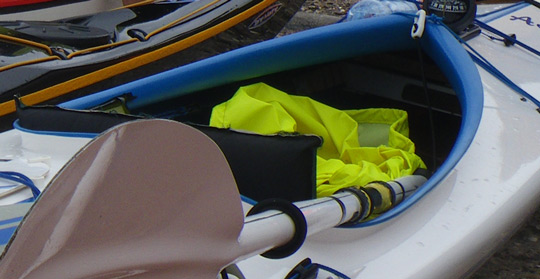 Example of kayak without wings in the cockpit, offering less knee grip and less control for eskimo rolls and edging. Do not choose a kayak like this if you would like to do eskimo rolls.
