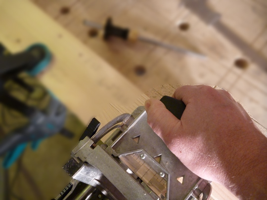 The Festool Domino held stable and horizontal using an additional piece of wood