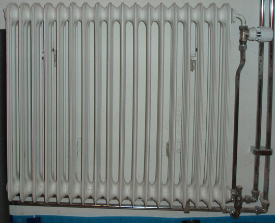 A radiator which has been mounted on a wall where previously no radiator existed.